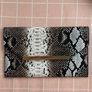 The Limited Snake Print Clutch Bag